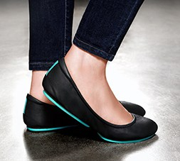 Tieks with their classic teal sole